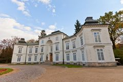 Myslewicki Palace (1779) in Royal Baths Park of Warsaw, Poland Royalty Free Stock Photo
