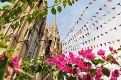 Mysore gothic Cathedral with colorful prayer flags. St. Philomena's gothic Cathedral in Mysore, one of the largest churches in India, Mysore, Karnataka Royalty Free Stock Photo