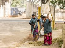 Indian women cleaning road in the street stock photo