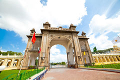 Mysore. The main palace complex. Palace of the Maharaja of Mysore. Main Gates.  Sunny day, flying clouds Royalty Free Stock Photo