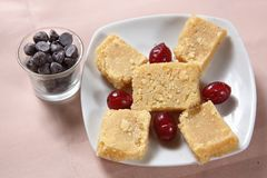 Mysore Pak, Gram Flour Sweet, Mysuru Paaka. Mysore pak is a sweet dish of Karnataka, it is a sweet dish and can be prepared on occasions.Gram flour, ghee and stock photos