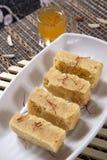 Mysore pak, Mysuru paaka. Mysore pak originally called as Mysuru Paaka is an Indian sweet prepared in ghee that is popular in Southern India. It originated in Stock Photo
