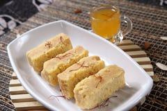 Mysore pak, Mysuru paaka. Mysore pak originally called as Mysuru Paaka is an Indian sweet prepared in ghee that is popular in Southern India. It originated in Royalty Free Stock Photography