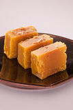 Mysore Pak is a traditional sweet from India. Mysore Pak is a Sweet dish made from gram flour, sugar and ghee royalty free stock photography