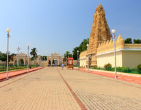 Mysore Palace gate. Mysore Palace grounds have many outbuildings and ancient walls plus temples gopurams pagodas and gates and caravans and carriages in the huge Stock Images
