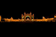 Mysore Palace illuminated at night. Stock Photos