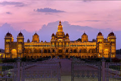 Mysore Palace. MYSORE,INDIA - FEBRUARY 22 : Mysore Palace glowing at twilight time on February 22,2011 Mysore India Stock Photo