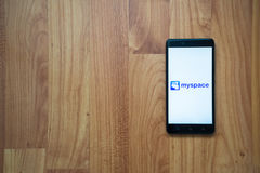 Myspace on smartphone. Los Angeles, USA, july 13, 2017: Myspace logo on smartphone screen on wooden background Stock Photos