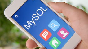 MySQL concept application on the smartphone. Man uses mobile app. Stock footage stock video footage