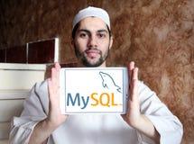 MySQL open source web application logo. Logo of MySQL open source web application on samsung tablet holded by arab muslim man. MySQL is an open-source relational Stock Photo