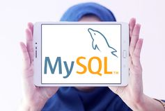 MySQL open source web application logo. Logo of MySQL open source web application on samsung tablet holded by arab muslim woman. MySQL is an open-source Stock Photos
