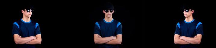 Красивый молодой человек с крышкой и солнечными очками - коллажем myster стоковая фотография rf