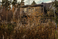 Mysterious abandoned wooden house Royalty Free Stock Image