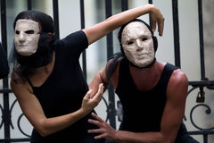 Mysterious actors wearing masks. Royalty Free Stock Photo