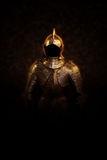 Mysterious ancient suit of armour in dark shadows Royalty Free Stock Photos