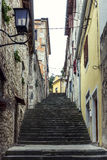 The mysterious atmosphere of the old Mediterranean town. Narrow street with stairs in the old town stock photo