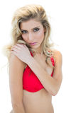 Mysterious attractive blonde model in red bikini looking at camera Stock Photo