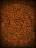 Mysterious Aztec Background. Background with the mysterious Aztec Stone Calendar Stock Images