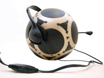 Mysterious Ball HP Two. Floating Black & Gray patterned Rubber Ball wearing a microphone & speaker headset royalty free stock photos