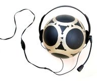 Mysterious Ball NHP. Black & Gray patterned Rubber Ball wearing a microphone & speaker headset stock photos