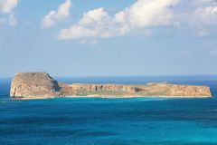Mysterious Balos bay, island Crete, Greece. In the azure sea there are mountains edged with the water. Sky with clouds. Waves. Landscape in sunny day royalty free stock photo