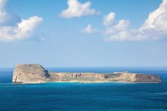 Mysterious Balos bay, island Crete, Greece. In the azure sea there are mountains edged with the water. Sky with clouds. Waves. Landscape in sunny day stock photos