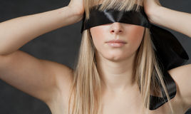 Mysterious beautiful face with ribbon blindfold on Stock Images