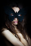 Mysterious beautiful girl in  butterfly mask Royalty Free Stock Photography