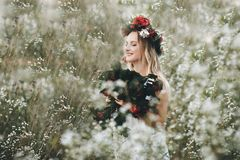 Mysterious beautiful girl with flowers in her hair stock photography