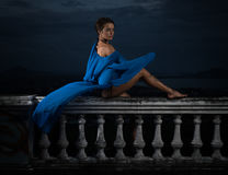 Mysterious beautiful woman over cloudy sky and cityscape Stock Photography