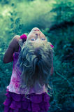 Mysterious blond girl Stock Images