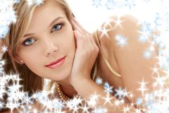 Mysterious blue-eyed blond in pearls Stock Photo