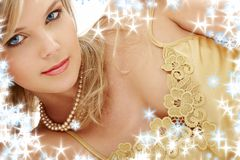 Mysterious blue-eyed blond in pearls Royalty Free Stock Images