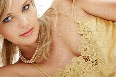 Mysterious blue-eyed blond in pearls puzzle Stock Photos