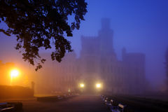Mysterious castle in fog night stock photos