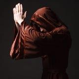 Mysterious Catholic monk. Studio shot Royalty Free Stock Photo