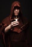 Mysterious Catholic monk. Studio shot Royalty Free Stock Image