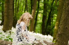 Mysterious child in woods Stock Images