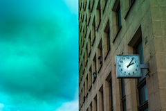 Mysterious city building. Mysterious russian building public property with an old clock Royalty Free Stock Image