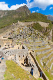 Mysterious city - Machu Picchu, Peru,South America. The Incan ruins and terrace. Example of  polygonal masonry Royalty Free Stock Image