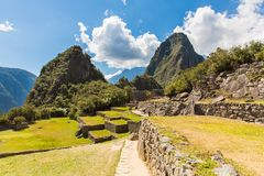 Mysterious city - Machu Picchu, Peru,South America. The Incan ruins and terrace. Example of  polygonal masonry Royalty Free Stock Photo