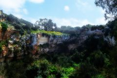 The Mysterious Crater known as il-Maqluba in Malta. The Mysterious Crater and forestation known as il-Maqluba in Malta Royalty Free Stock Photos