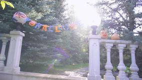 Mysterious creature approaching Halloween party, All Saints Eve celebration. Stock footage stock footage
