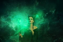 Free Mysterious Dark Elf Got Terrible Curse, Charming Girl With Horns On Head And Glowing Sparkling Magic Stick In Hands Royalty Free Stock Photo - 144770085