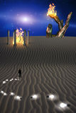 Mysterious Desert Scene. Trail of Idea bulbs in desert and fire in temple Stock Image