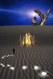 Mysterious Desert Scene. Trail of Idea bulbs in desert and fire in temple Royalty Free Stock Image