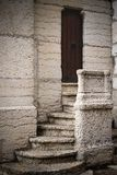Mysterious door. A tiny stairway leading to a mysterious door Stock Photography
