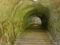 Mysterious dungeon tunnel with walls made of stone Stock Photography