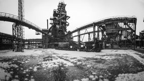 A mysterious dying iron factory in black and white. A big mysterious dying iron factory in black and white Stock Photos