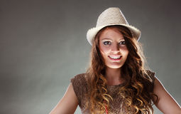 Mysterious enigmatic intriguing woman girl in hat. Portrait of mysterious enigmatic woman in studio on grey. Young intriguing attractive girl in hat. Shining Stock Photography